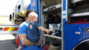 Bryce and Daddy check out a fire truck, and Daddy tells him about all of the parts he is seeing.